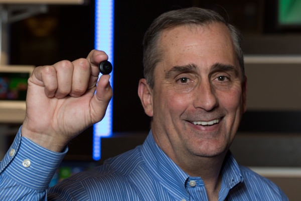 Intel's Brian Krzanich holds the IntelR CurieT button-sized prototype