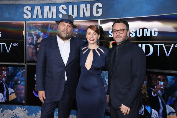 Actors Vincent D'Onofrio, Bryce Dallas Howard and Writer Director Colin Trevorrow pose in front of Samsung's SUHD TVs at the premiere of Jurassic World at Dolby Theatre on June 9, 2015 in Hollywood, California.
