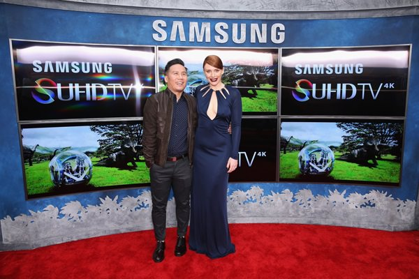 Actors B. D. Wong (L) and Bryce Dallas Howard pose in front of Samsung's SUHD TVs at the premiere of Jurassic World at Dolby Theatre on June 9, 2015 in Hollywood, California.