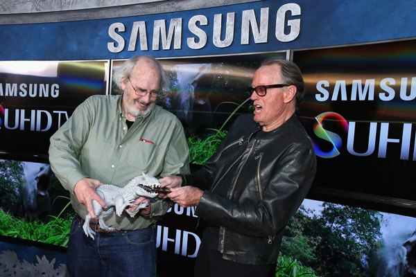 Actor Peter Fonda (L) and Paleontologist consultant Jack Horner poses in front of Samsung's SUHD TVs at the premiere of Jurassic World at Dolby Theatre on June 9, 2015 in Hollywood, California