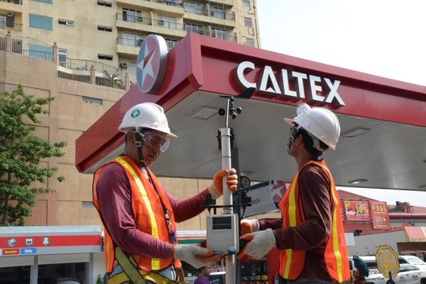Engineers calibrate one of the 18 AWS units that Caltex stations host in various points across Metro Manila