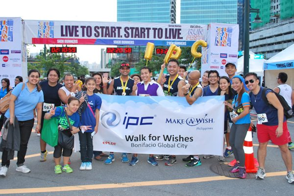 Team IPC with Wish Kid Amie (fifth from left) at the finish line