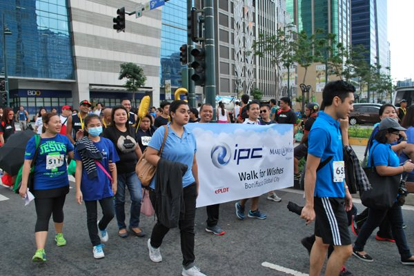 IPC employees keep in step with their Wish Kid during the 500-meter Walk for Wishes.