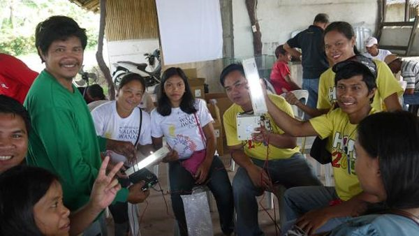 Let There Be Light. Gawad Kalinga volunteers are learning about how the new solar lamps from Schneider Electric can help in the rehabilitation of typhoon-stricken communities.
