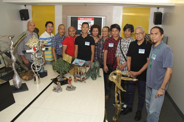 Some of the participating artists of the Rotary Club of Makati's Alay Sining 8 showcase their artworks during the exhibit's recent presscon: (L-R) Jaime Nepomuceno, Glen Cagandahan, Benjamin Dailo, Fred Caedo, Kish Javier, Helena Alegre, Merlito Gepte, Jaime Gubaton, Milmar Onal, Ral Arrogante, and Jinggoy Salcedo.