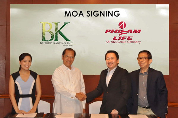 Photo shows (from left): Bangko Kabayan Corporate Planning Head Fides Ganzon-Ofrecio and President Francis Ganzon, and Philam Life Corporate Solutions Sales Head Erwin Go and Agency Manager Lito Melendres.