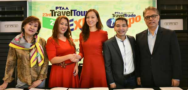 Globe Telecom Senior Vice President for Consumer Mobile Marketing Issa Cabreira (center) formalizes the partnership of the telco with PTAA President Michelle Victoria (2nd from left) for the 23rd Travel Tour Expo with Globe as official telco partner. Joining them are (L-R) 23rd Travel Tour Expo chair Lulu Velasco, Globe Vice President for Roaming and International Business Coco Domingo and PTAA co-chairman Marciano Ragaza III.