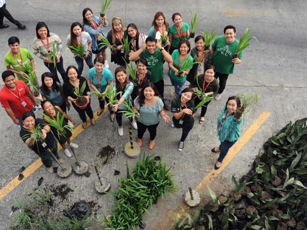 Philippines AirAsia CEO Joy Cañeba(front row, 4th from left) with the AirAsia team in the Philippines.