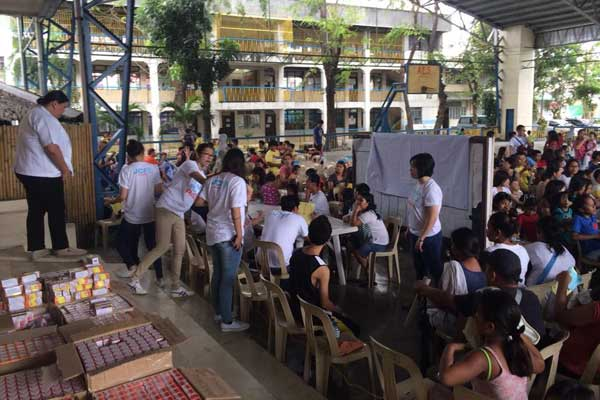 JCI Alabang Board of Directors with members and volunteers assist the 800 people from Muntinlupa go through their check up with the doctor and getting their free prescription medicines.