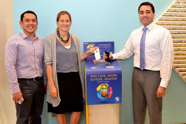 Globe Director for Corporate Social Responsibility Fernando Esguerra (left) joins Fotini Ali, U.S. Embassy Public Affairs associate and Michael Barrera, U.S. Embassy Vice Consul for immigrant visa section as they donate their e-waste.