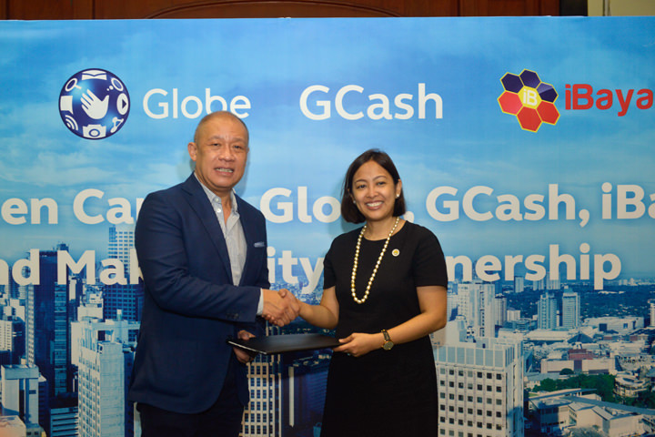 Makati to become country's first connected city. Globe President and CEO Ernest Cu with Makati City Mayor Abby Binay.