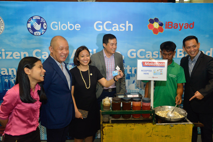 Mayor Abby Binay makes the first Makatizen Card transaction with a local fishball vendor.