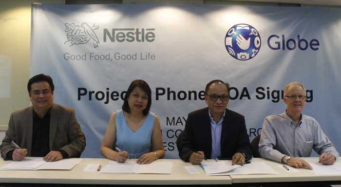 (L-R) Globe Business Vice President for Enterprise Sales Dion Asencio, Globe Senior Vice President for Corporate Communications Yoly Crisanto, Nestle' Philippines Senior Vice President for Corporate Affairs Ernie Mascenon and Nestle' Philippines Technical Director Peter Winter sign the Memorandum of Agreement for Globe Telecom and Nestle' Philippines' Project 1 Phone partnership.