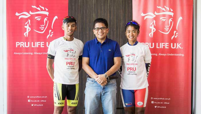 Pru Life UK President and Chief Executive Officer Antonio De Rosas (center) with pro cyclists Oconer and Salamat