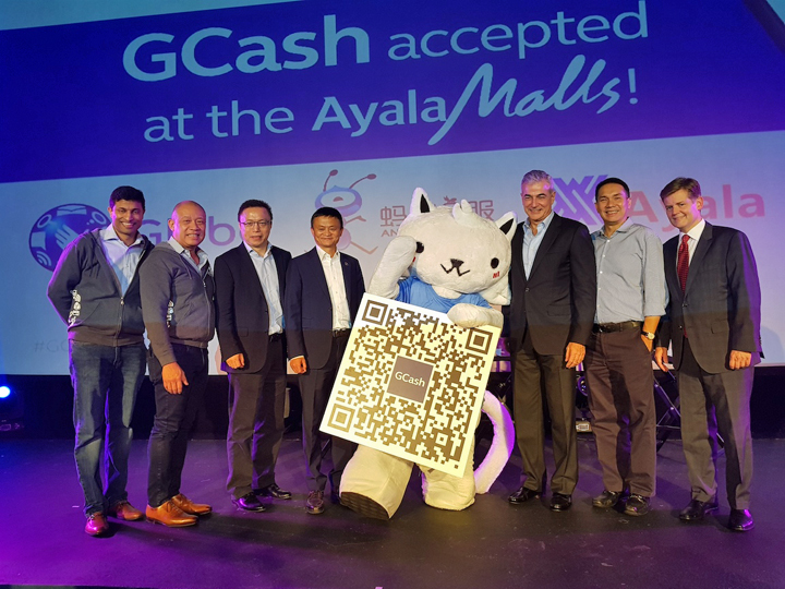 Alibaba Founder and Executive Chairman Jack Ma (center, left) joins GCat, the GCash Mascot as it shows a sample of the QR code that is set to change the landscape of payments in the country. Together with him are (from L-R): Mynt President and CEO Anthony Thomas, Globe President and CEO Ernest Cu, Ant Financial Services Group CEO Eric Jing, Ayala Corporation President and COO Fernando Zobel de Ayala, Ayala Land President and CEO Bobby Dy, and Ant Financial SVP and Head of International Operations Douglas Feagin.