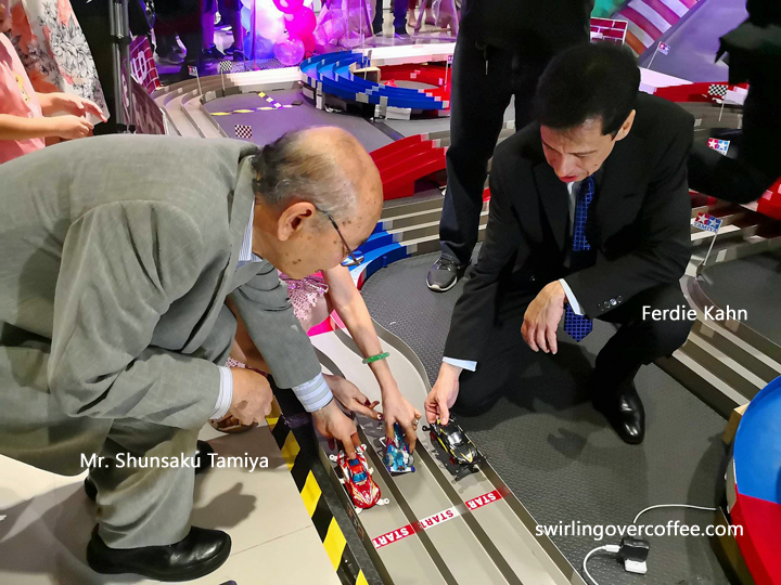 Tamiya President and Chairmman Shunsaku Tamiya and Lil's Hobby Center owner Ferdie Kahn, try out the tracks at the newly openned The BrickYard.