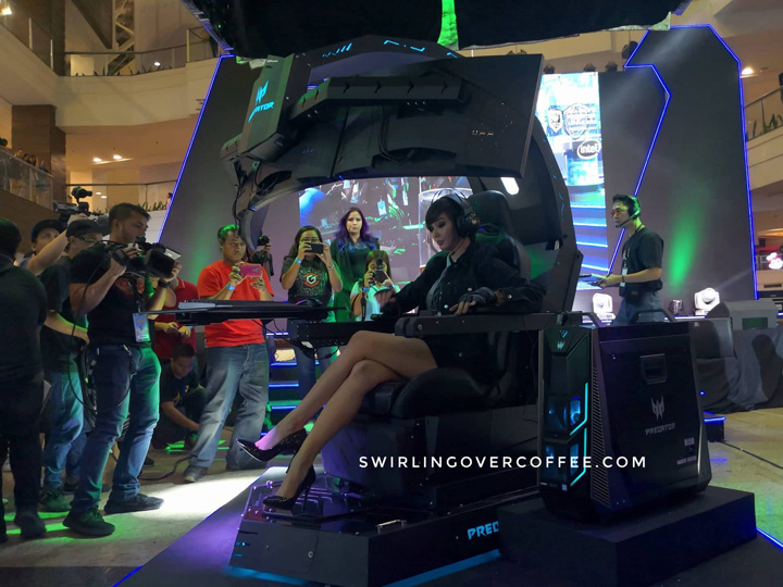 Alodia Gosiengfiao sits on the Predator Thronos Gaming Chair