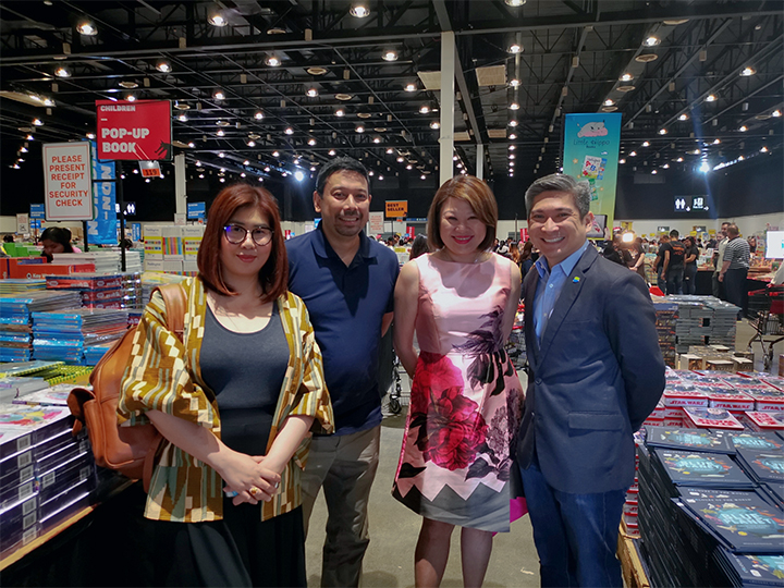 In photo are Jacqueline Ng, Founder of Big Bad Wolf (2nd from right); Kenneth Palacios, Director and Head of Wallets Business at PayMaya (rightmost); Luis Oquiñena, Executive Director of Gawad Kalinga; and Nick Wilwayco, Head of PR and Communications at Voyager Innovations.