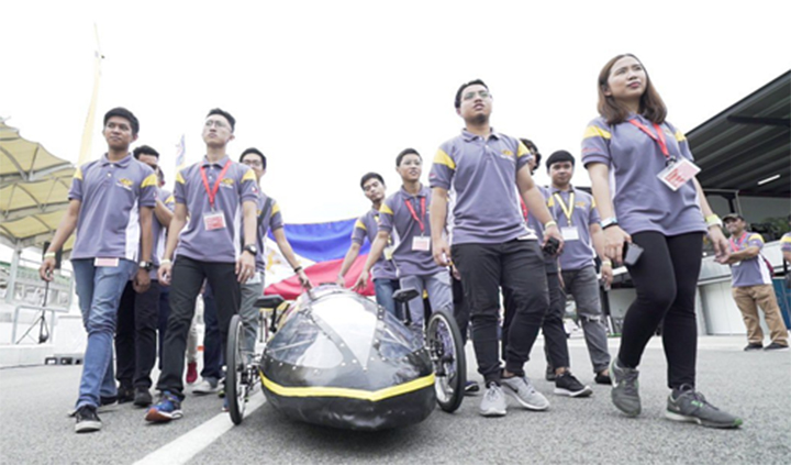 University of Sto. Tomas' UST Eco-Tigers I marching into track with their Prototype category vehicle T400D