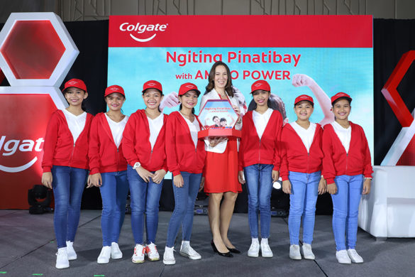 Colgate-Palmolive Philippines, Inc. Marketing Director Emily Fong Mitchell with Tenement Elementary School students during the Colgate Maximum Cavity Protection Toothpaste with Amino Power Launch Event.