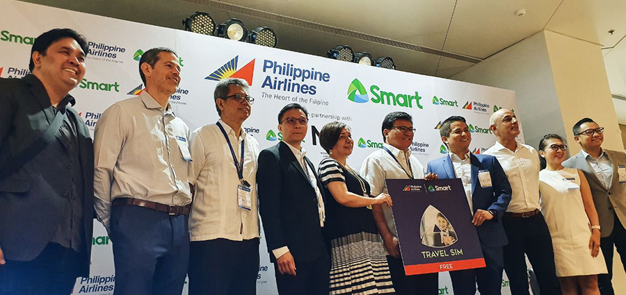 SMART PAL TRAVEL SIM LAUNCH. L-R PLDT VP and Deputy Head for Public Affairs Carlo Ople, PHAR CEO Marcus Wright, PAL AVP for Ancillary Business Programs Alfred Montemayor, PAL Chief Commercial and Marketing Officer Eugene Go, NAIA Terminal 1 Manager Irene P. Montalbo, PAL President and COO Gilbert Santa Maria, PLDT SVP for Consumer Business – Individual Group Oscar Enrico A. Reyes Jr., PHAR Managing Director for ASIA Prem Bahtia, FVP and Head of Key Accounts Precy Katigbak and VP and Head of Smart Prepaid Marketing Gerard Milan.