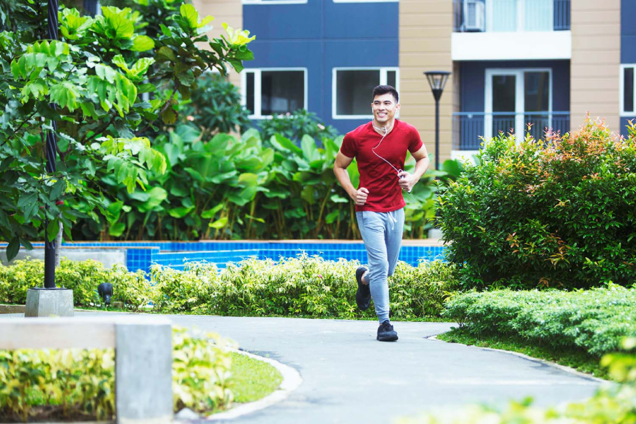The tree-laned jogging path invites residents to get moving and have their morning run.