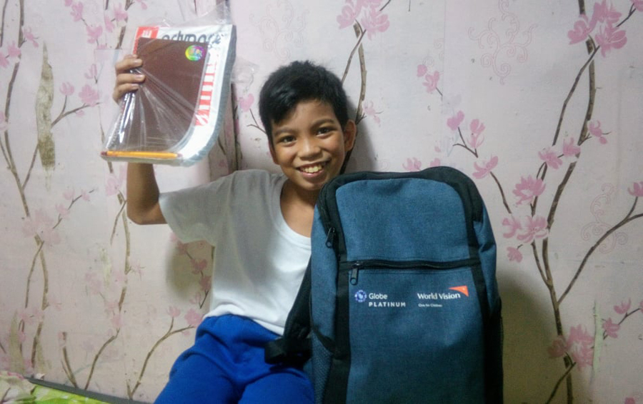 Students in Baseco, Manila receive almost a thousand World Vision school kits raised by Globe Platinum customers