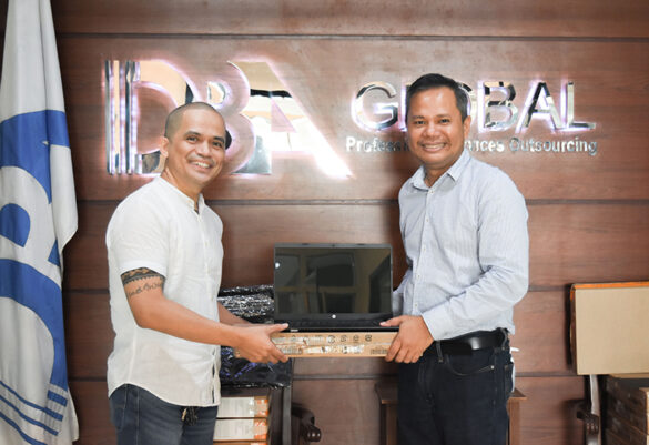 CAB Chief Legal Officer Atty. Wyrlou Samodio (left) receives donated laptops from DBA president and CEO Darlow Parazo.
